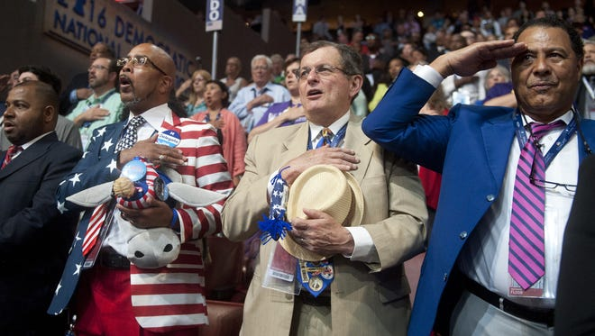 Louisiana delegates stand during the National Anthem during the Democratic National Convention in Philadelphia on Wednesday.  06.27.16