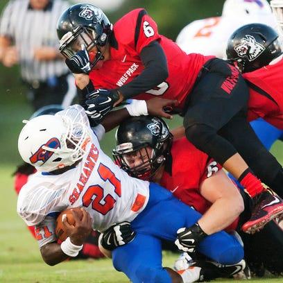 South Fort Myers High School's Jeshaun Jones, top,