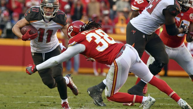 Tampa Bay Buccaneers wide receiver Adam Humphries (11) runs past a tackle attempt by Kansas City Chiefs defensive back Ron Parker (38) during the second half Sunday in Kansas City.