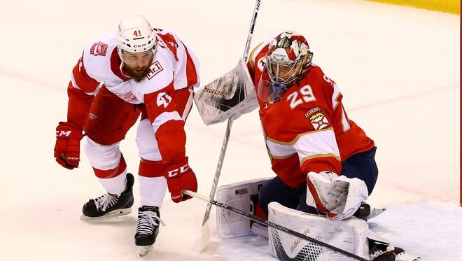 Florida Panthers goalie Harri Sateri (29) makes a save as Detroit Red Wings center Luke Glendening (41) looks for the rebound in the first period at BB&T Center.