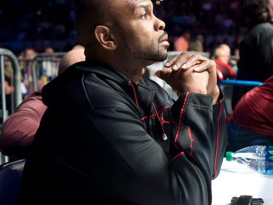 Roy Jones, Jr. sits ringside during the undercard fights Saturday night an offers words of encouragement to the fighters boxing out of the Square Ring corner.
