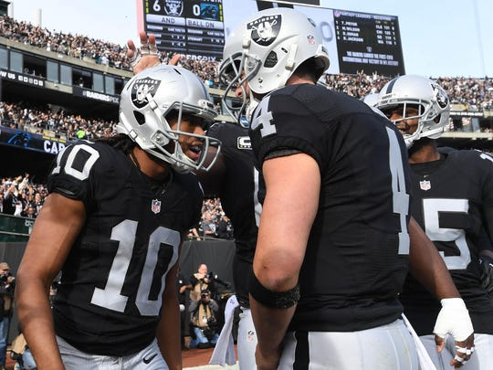 Oakland Raiders wide receiver Seth Roberts, a former Maclay School star, celebrates with quarterback Derek Carr after scoring his second touchdown against the Carolina Panthers during a game last season.