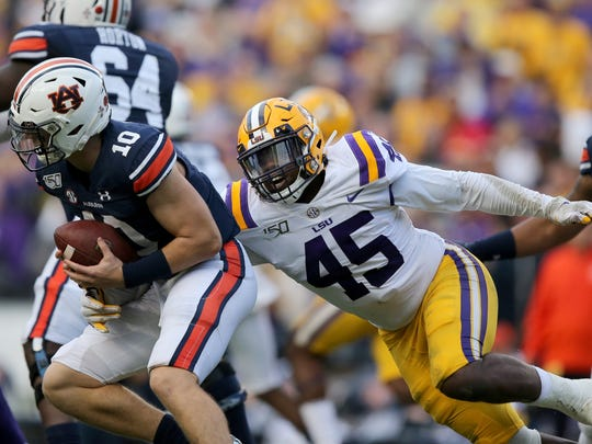 Following a six-game suspension, LSU Tigers linebacker Michael Divinity Jr. (45) returns for Monday's national title game.
