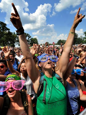 Bonnaroo's enthusiastic crowd makes the four-day music festival a must-see for many. Melissa Sadik and Suzanne Hirt, both of New York City, enjoy the indie-pop duo Capital Cities at Bonnaroo in 2014.
