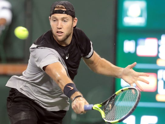 Jack Sock returns the ball to Feliciano Lopez, of Spain,