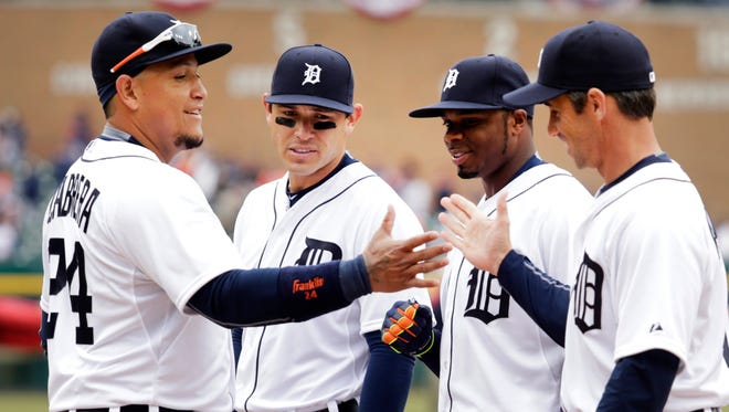 Detroit Tigers first baseman Miguel Cabrera, left, gets a high-five from manager Brad Ausmus as he is announced to the fans prior to the Opening Day game Monday, April 6, 2015, in Comerica Park.