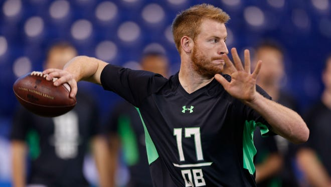 North Dakota State Bisons quarterback Carson Wentz throws a pass during the 2016 NFL Scouting Combine at Lucas Oil Stadium.