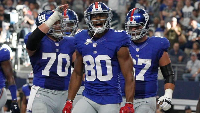 New York Giants wide receiver Victor Cruz (80) reacts after catching a touchdown pass in the fourth quarter against the Dallas Cowboys at AT&T Stadium on Sept. 11, 2016.