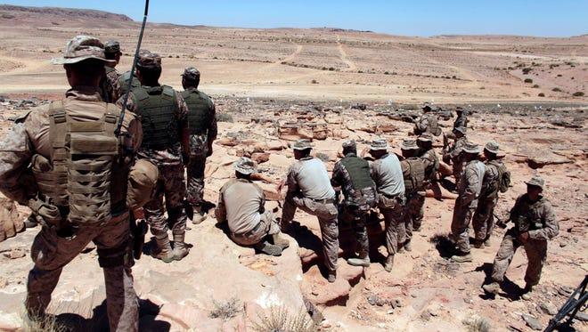 U.S. Marines monitor multinational military maneuvers in Quweira, 186 miles south of Amman, Jordan, in June.