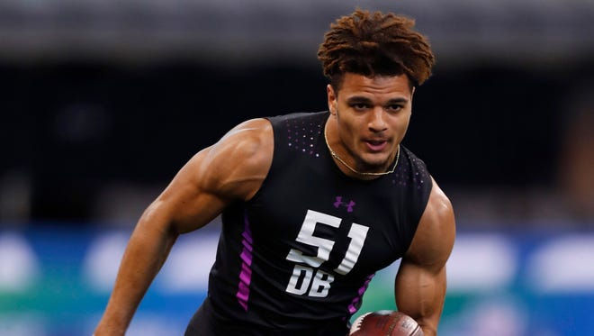 Alabama Crimson Tide defensive back Minkah Fitzpatrick goes through work out drills during the 2018 NFL Combine at Lucas Oil Stadium.