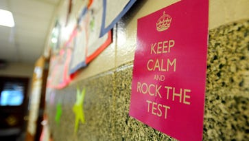 A motivational poster hangs outside a Woodvale Elementary classroom in 2013 as students take the LEAP tests. Legal and policy changes now allow parents to see the tests their students have taken.