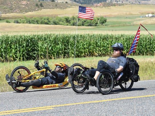 Fort Collins veterans Rustin Hughes, left, and Dustin
