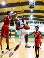Bossier's Dante Bell drives to the basket during their game against Richwood Saturday evening at the Bossier Invitational basketball tournament.