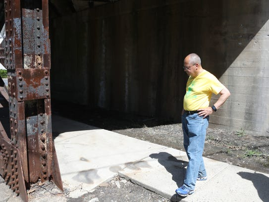 Chatham Council President, Len Resto, looks at a rusty