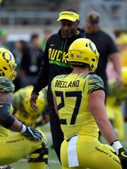 Oregon head coach Willie Taggart walks on the field before the game against Washington State.