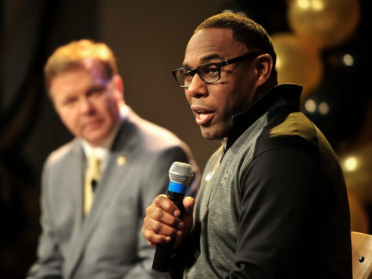 Vanderbilt Head Coach Derek Mason, right, speaks during the National Signing Day event at Vanderbilt on Wednesday, Feb. 4, 2015.