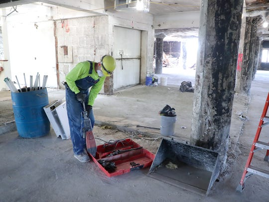 Former Larsen Canning buildings renovation is ongoing Thursday, May 24, 2018 on North Broadway in Green Bay, Wis. Martin Stefanov works on clearing the third floor which is slated to be commercial space.