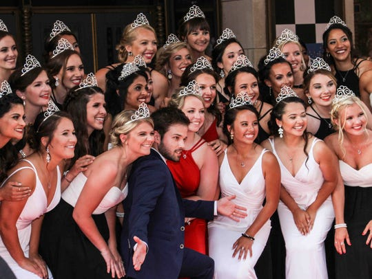 Indy 500 princesses pose with actor and director Nathan Kress on the red carpet at the annual KeyBank 500 Festival Snakepit Ball celebrating the Indianapolis 500 in May 2017.