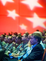 A full house attends the opening of the Air Force Information