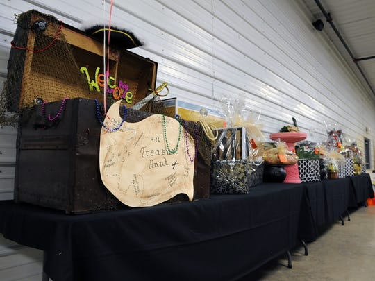 Earlybird prizes line the back wall at the first Muskingum County Reverse Raffle event. Proceeds from the raffle were donated to the Muskingum County 4-H program.
