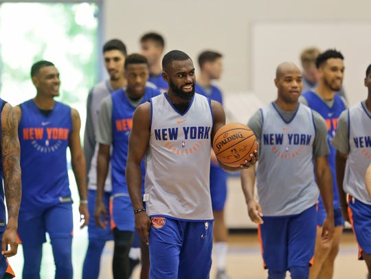 New York Knicks' Tim Hardaway Jr., center, participates