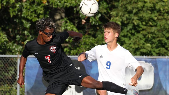 Nyack's Tariku Smith, left, fights for the ball with