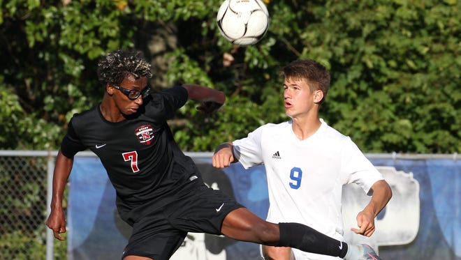 Nyack's Tariku Smith, left, fights for the ball with Pearl River's Denis Fleming during their game at Pearl River Oct. 3, 2017. The game ended in a 1-1 tie.