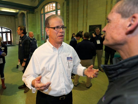 U.S. Senate candidate Mike Braun talks with people gathered at the Indiana Republican Party's Congress of Counties U.S. Senate Straw Poll event at the Union Station Grand Hall Saturday, Jan 13, 2018.