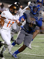 Angelo State's Melvin Robinson moves in to tackle a UTPB Falcon on Saturday night.