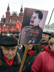 Russian communist party supporters line up to place