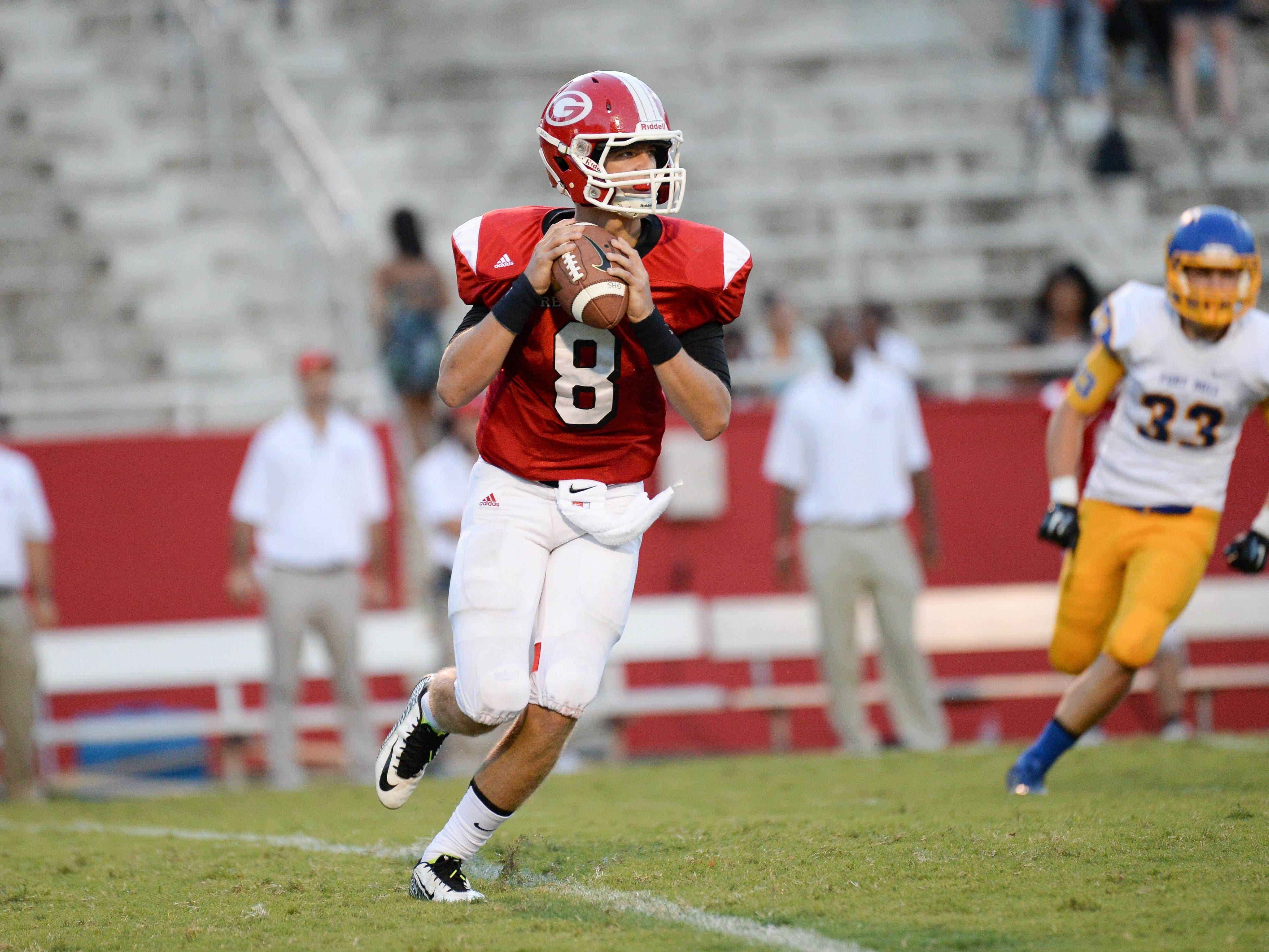 Greenville's Carson Spiers (8) passed for 288 yards with three touchdowns against Fort Mill on Friday.