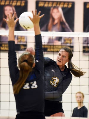 Oak Grove's Breleigh Favre spikes the ball over the net in a home game against PCS on Thursday.