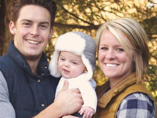 Davey and Amanda Blackburn pose with their child, Weston.