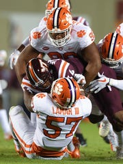 Clemson defensive lineman Dexter Lawrence (90), top,