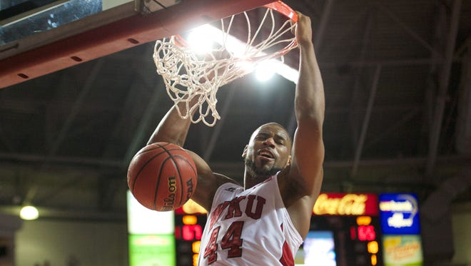 Jan 22, 2015; Bowling Green, KY, USA; Western Kentucky Hilltoppers forward George Fant (44) dunks the ball during the second half against UTEP Miners at E.A. Diddle Arena. Western Kentucky Hilltoppers defeated UTEP Miners 71-66 in overtime. Mandatory Credit: Joshua Lindsey-USA TODAY Sports