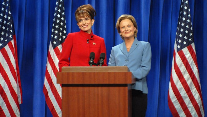 "In this Sept. 13, 2008 photo released by NBC, Tina Fey portrays Alaska Gov. Sarah Palin, left, and Amy Poehler as Sen. Hillary Clinton during a skit on ""Saturday Night Live,"" in New York. The long-running sketch comedy series will celebrate their 40th anniversary with a 3-hour special airing Sunday at 8 p.m. EST on NBC."