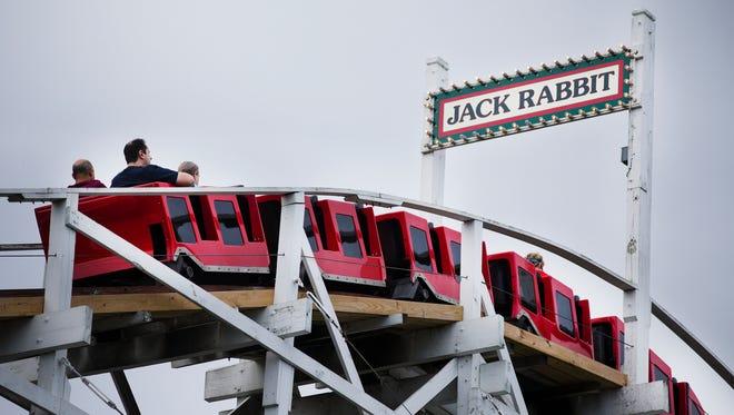 Riders on the Jack Rabbit at Seabreeze Amusement Park on Saturday, Aug. 15, 2015.