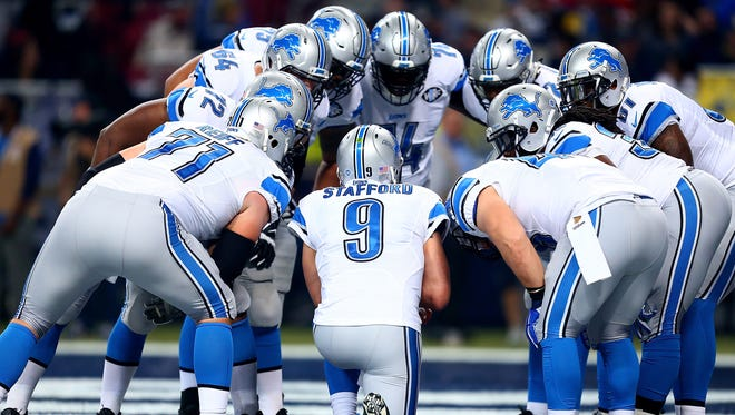 The Detroit Lions huddles around Matthew Stafford #9 in the second quarter against the St. Louis Rams at the Edward Jones Dome on December 13, 2015 in St. Louis, Missouri.