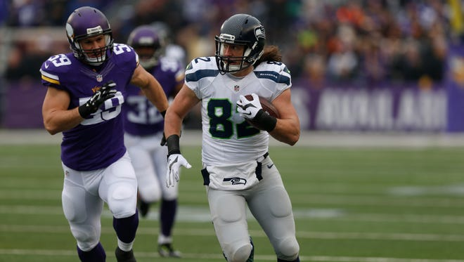 Seattle Seahawks tight end Luke Willson (82) runs with the ball against the Minnesota Vikings in the first half of an NFL football game Sunday, Dec. 6, 2015 in Minneapolis.