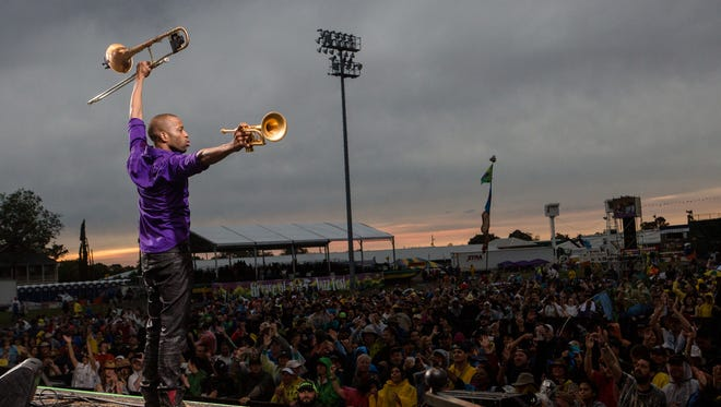 Trombone Shorty performs at the New Orleans Jazz & Heritage Festival at Fair Grounds Race Course on the final day of the music celebration.