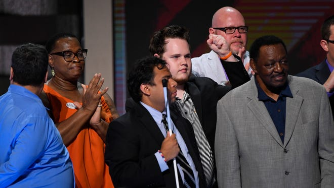 Tennessee delegate Nathaniel Bone, second row middle, cheers on stage during the 2016 Democratic National Convention at Wells Fargo Arena in Philadelphia.