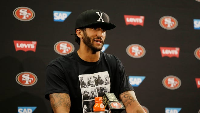 San Francisco 49ers quarterback Colin Kaepernick answers questions at a news conference after an NFL preseason football game against the Green Bay Packers Friday, Aug. 26, 2016, in Santa Clara, Calif. Green Bay won the game 21-10.