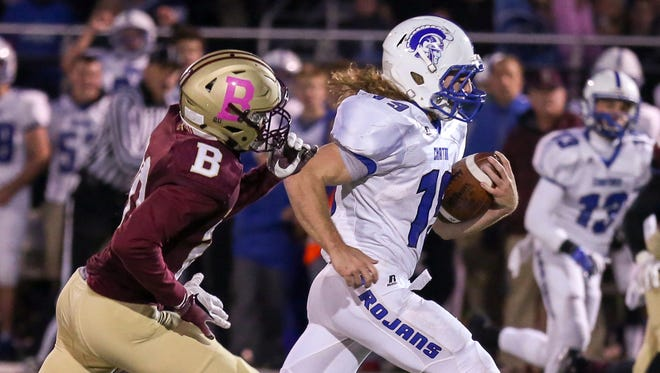 Jarrod Stiver of Bishop Chatard races for the end zone in the Trojans' 28-7 win over Brebeuf Jesuit.