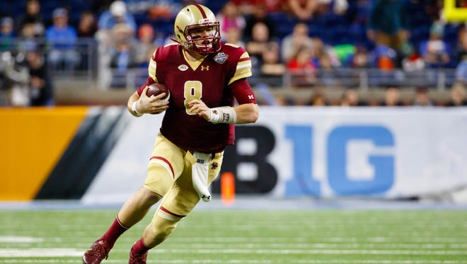 Boston College Eagles quarterback Patrick Towles (8) rushes in the first half against the Maryland Terrapins at Ford Field on Dec. 26, 2016.