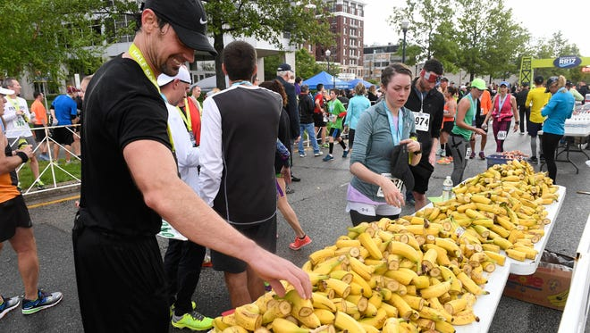 Runners fuel up on bananas after finishing the 2017 River Run Saturday, May 6, 2017.