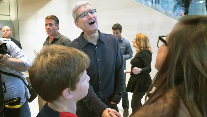 Apple CEO Tim Cook greets guests at the grand opening of Apple's Chicago flagship store on Michigan Avenue on Oct. 20.