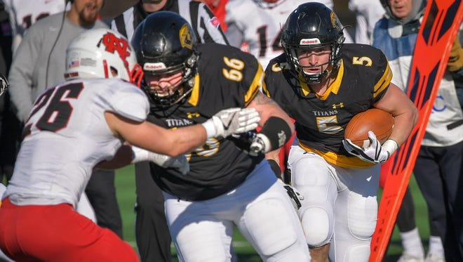 UW-Oshkosh's Ty Summers (66) blocks for Mitch Gerhartz (5) in the first half of a second-round playoff game against North Central College on Saturday.