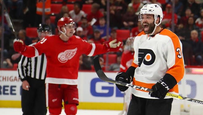 The Flyers' Radko Gudas celebrates in front of Red Wings forward Dylan Larkin in overtime of the Wings' 3-2 overtime loss on Tuesday, Jan. 23, 2018, at Little Caesars Arena.