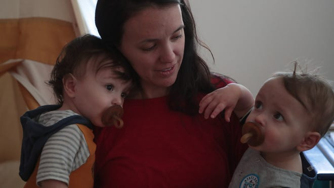 Since giving birth to twins, Ashton, left, and Hudson, Janet Gassaway has started her own business which allows her to work from home, Thursday, January 25, 2018.