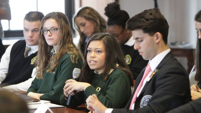 Samantha McBurrows, a student at Our Lady of Mercy Academy in Newfield, speaks during a discussion about gun violence with Bishop Dennis Sullivan.